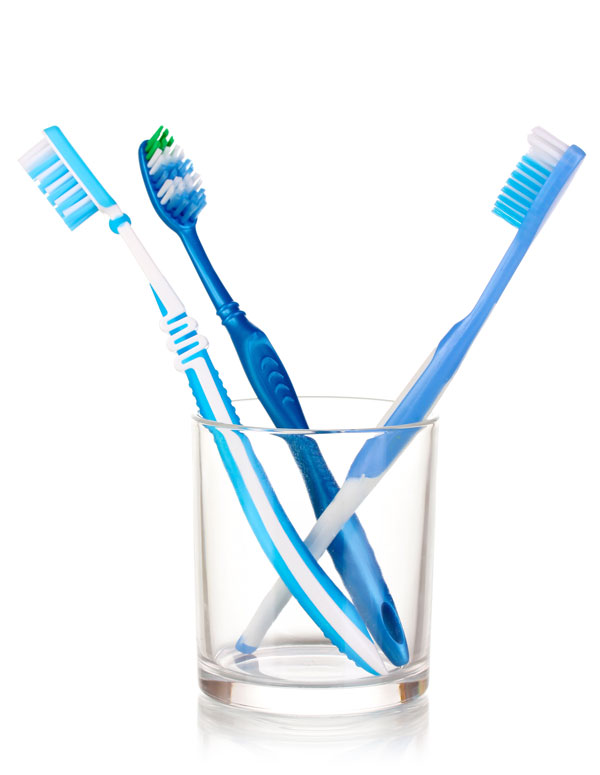 glass containing toothbrushes